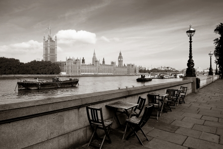 Chairs at waterfront of Thames River with Big Ben and House of Parliament in London. photo