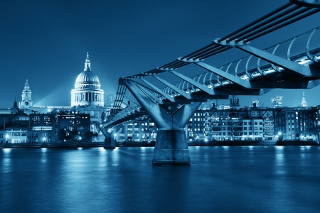 london city: Millennium Bridge and St Pauls Cathedral at night in London