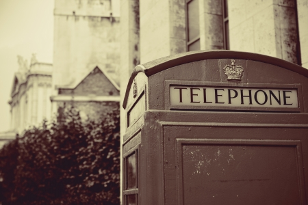 historical architecture: telephone booth in street with historical architecture in London.