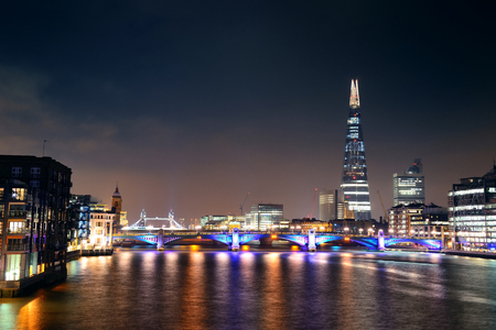 southwark: Southwark Bridge and London skyline at night.