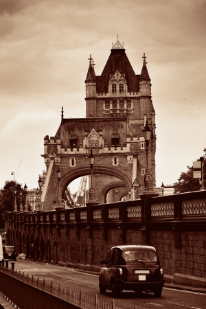 taxi famous building: Tower Bridge closeup with vintage taxi in London. Editorial