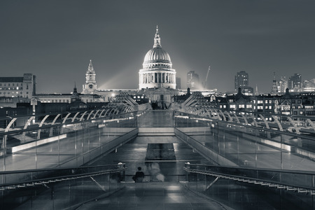 iconic: Millennium Bridge and St Pauls Cathedral at night in London
