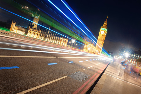 light trail: Light trail on Westminster Bridge with Big Ben at night in London. Stock Photo
