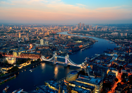 London aerial view panorama blended with sunset and night with urban architectures.