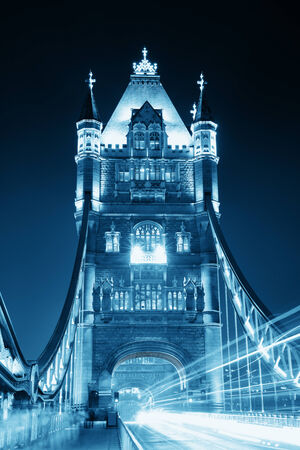 Tower Bridge in London with busy traffic at night. Stock Photo
