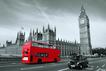 Double-deck red bus on Westminster Bridge with Big Ben in London. photo