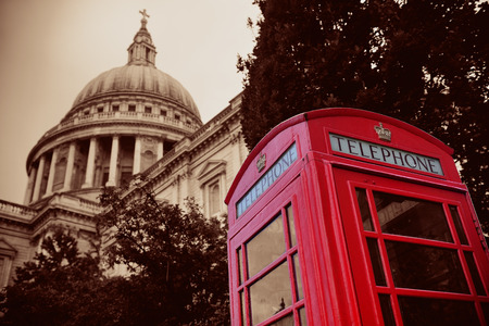 st pauls: Red telephone booth and St Pauls Cathedral in London. Stock Photo