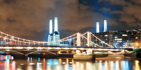 powerstation: Battersea Power Station panorama over Thames river as the famous London landmark at night. Stock Photo