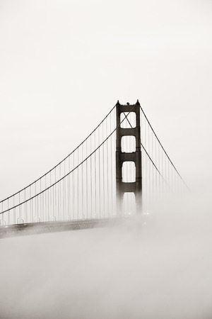 fog white: Golden Gate Bridge tower in fog closeup in San Francisco