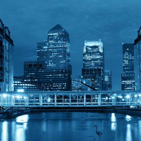 iconic: Canary Wharf business district in London at night over Thames River.