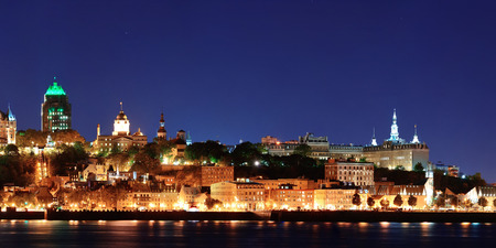 Quebec City skyline at dusk over river viewed from Levis. photo