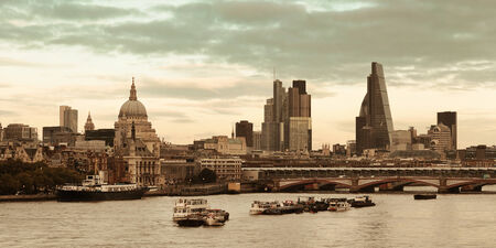 iconic: London cityscape at sunset panorama with urban buildings over Thames River