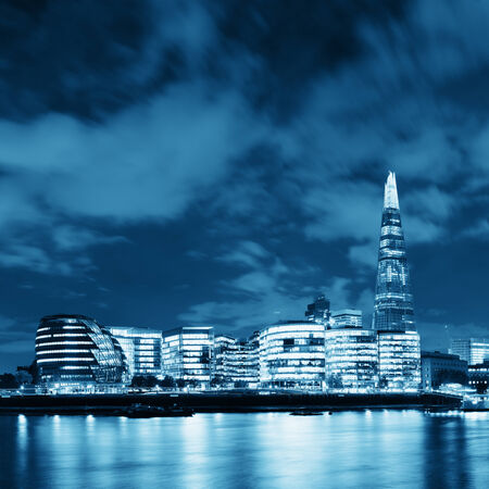 iconic: London urban architecture over Thames River at night Stock Photo