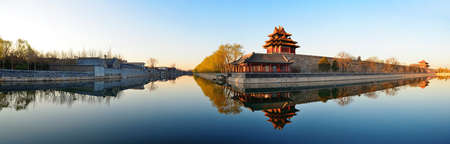 Imperial Palace over lake in the morning in Beijing. photo