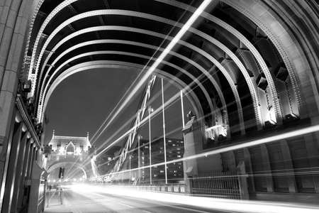 Tower Bridge in London with busy traffic at night