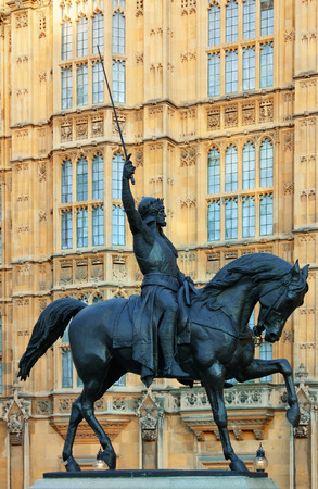 House of Parliament with statue in Westminster in London.