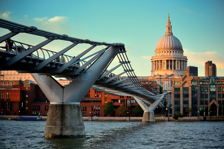 iconic: St Pauls cathedral in London and bridge over Thames River.  Stock Photo