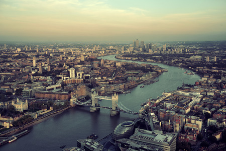 London rooftop view panorama at sunset with urban architectures and Thames River.