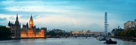 westminster: Thames River panorama with London Eye and Westminster Palace in London.