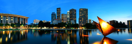 panoramic: Los Angeles downtown at night with urban buildings and lake