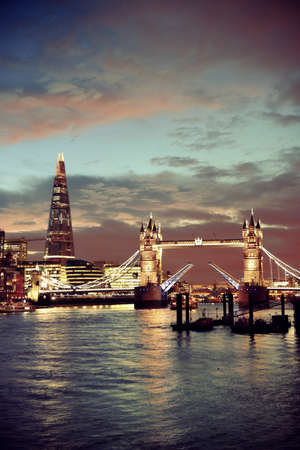 thames: The Shard and Tower Bridge over Thames River in London at dusk. Stock Photo