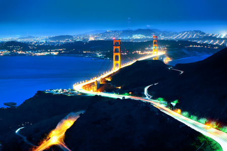 Golden Gate Bridge in San Francisco viewed from mountain top at night photo