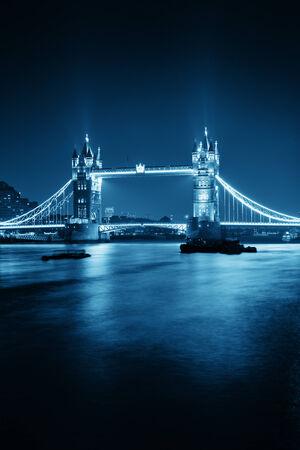 Tower Bridge in London in blue tone at night.