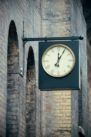 historical architecture: Urban historical architecture with vintage clock in street in London. Stock Photo