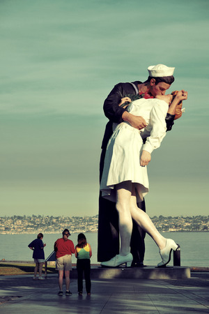San Diego, CA - MAY 18: Unconditional Surrender sculpture at sea port on May 18, 2014 in San Diego. By Seward Johnson, the statue resembles the photograph of V–J day in Times Square