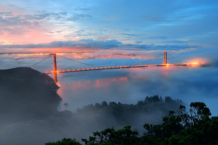 Golden Gate Bridge and fog in San Francisco in early morning Stock Photo