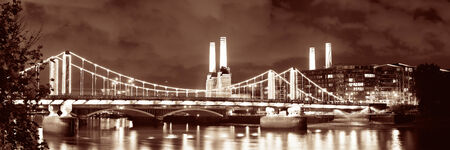 Battersea Power Station panorama over Thames river as the famous London landmark at night. photo