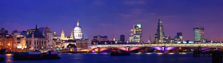 London skyline at night with bridge and St Pauls Cathedral over Thames River
