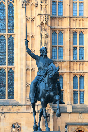 westminster: House of Parliament with statue in Westminster in London.
