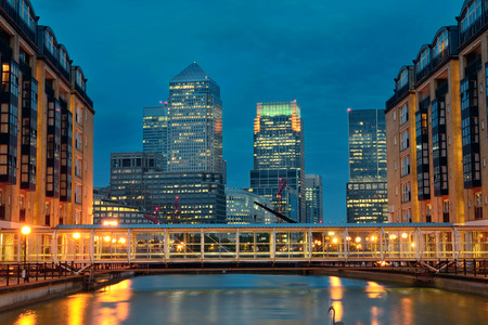 wharf: Canary Wharf business district in London at night over Thames River.
