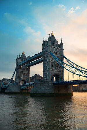Tower Bridge silhouette over Thames River in London. photo