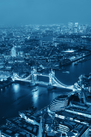 city  buildings: London aerial view panorama at night with urban architectures and Tower Bridge in BW.