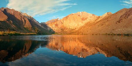 convict lake: Snow mountain and lake with reflections panorama in Yosemite.