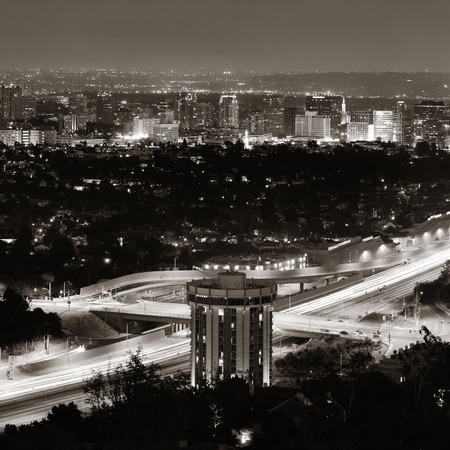 Los Angeles at night with urban buildings and highway photo