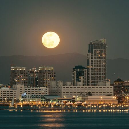 San Diego downtown skyline and full moon over water at night photo