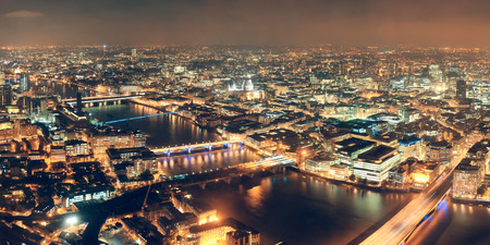 aerial: London aerial view panorama at night with urban architectures and bridges. Stock Photo