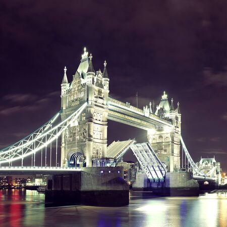 old bridge: Tower Bridge over Thames River at night in London
