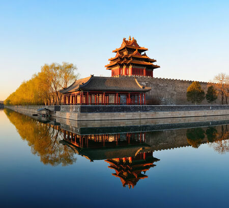 history building: Imperial Palace over lake in the morning in Beijing. Editorial