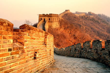 Great Wall sunset over mountains in Beijing, China.