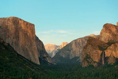 Yosemite Valley at sunset with mountains and waterfalls photo