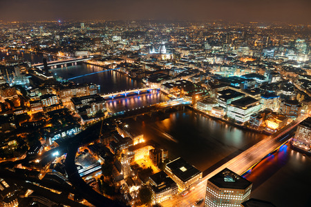 London aerial view panorama at night with urban architectures. photo