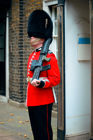 buckingham palace: LONDON, UK - SEP 27: British Guard on duty on September 27, 2013 in London, UK. The ceremony is one of the top attractions in London and UK military traditions.