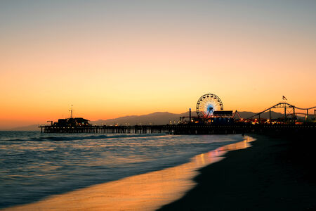 docks: Santa Monica Pier on beach in Los Angeles Stock Photo