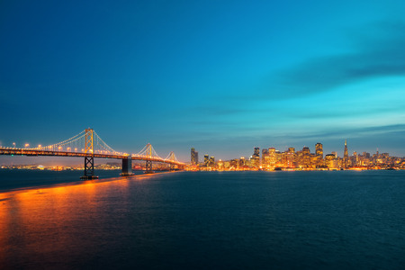 san francisco: Bay Bridge and San Francisco downtown skyline at dusk