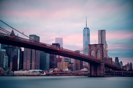 Manhattan financial district with skyscrapers and Brooklyn Bridge. photo
