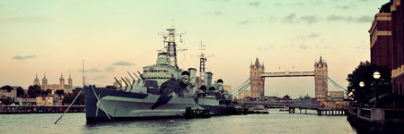 hms: HMS Belfast warship and Tower Bridge in Thames River in London